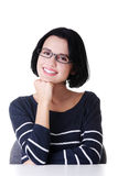 Smiling student girl sitting at the desk Royalty Free Stock Photos