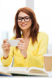 Smiling student girl with smartphone at school Royalty Free Stock Photo