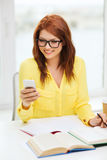 Smiling student girl with smartphone at school Royalty Free Stock Photos