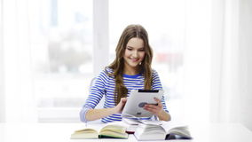 Smiling student girl with tablet pc and books stock video footage