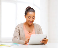 Smiling student girl with tablet pc Stock Photography