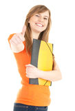 Smiling student girl with thumb up Stock Photos