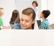 Smiling student girl with white blank board Royalty Free Stock Photos