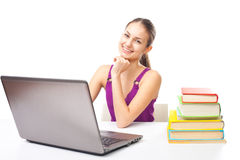 Smiling student girl working on a laptop Royalty Free Stock Photography