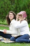 Smiling student girls on nature Royalty Free Stock Photo