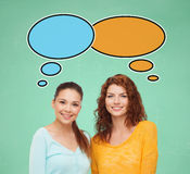 Smiling student girls with text bubbles Stock Photo