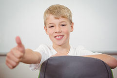Smiling student giving a thumbs up. At the elementary school Stock Photography