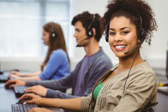 Smiling student with headset using computer Stock Photos