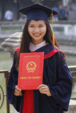 Smiling student with her diploma Stock Photos
