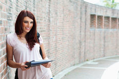Smiling student with her notes. Outside a building Stock Images