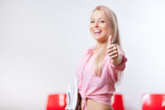 Smiling student with her thumb up and smiling stock photography