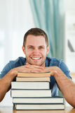 Smiling student with his books Stock Images