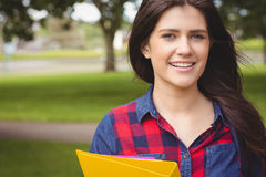 Smiling student holding binder Stock Images