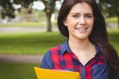 Smiling student holding binder Stock Images