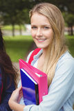 Smiling student holding binder Royalty Free Stock Image