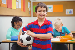 Smiling student holding a football Royalty Free Stock Images