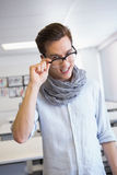 Smiling student holding his glasses. At the college Stock Photography