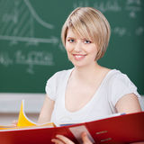 Smiling student holding a large binder Stock Images