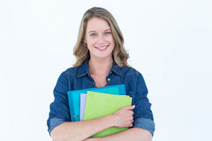 Smiling student holding notebook and file Royalty Free Stock Photo