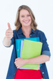 Smiling student holding notebook and file Royalty Free Stock Image