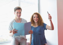 Smiling student holding notebook and pen. At the college Royalty Free Stock Photo