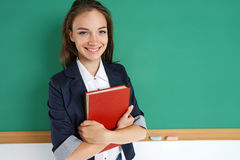 Smiling student hugging books. Stock Photos