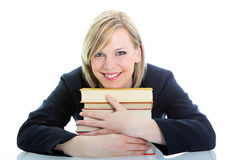 Smiling student hugging her books Stock Photo