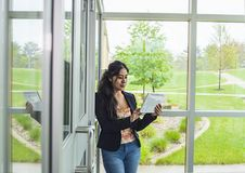 Smiling student inside college stock images