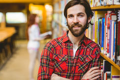 Smiling student in the library Royalty Free Stock Photos