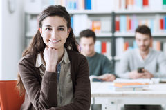 Smiling student at the library Royalty Free Stock Image