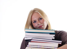 Smiling student with load of books Royalty Free Stock Photo