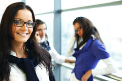 Smiling student. Student meeting smiley girl face on foreground Stock Photo