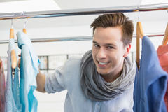 Smiling student near clothes rack. At the college Stock Images
