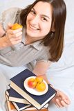 Smiling student  with  peach Stock Images