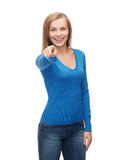 Smiling student pointing finger at you Stock Photography
