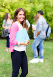 Smiling student portrait holding a book Stock Image