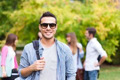 Smiling student portrait at the park. Outdoor portrait of a smiling student Royalty Free Stock Photography