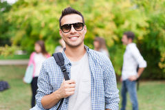 Smiling student portrait at the park. Outdoor portrait of a smiling student Stock Images