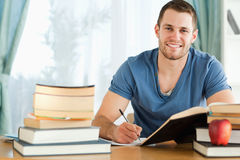 Smiling student preparing for test Stock Photography