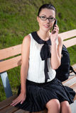 Smiling student or school girl talking on mobile phone Royalty Free Stock Photos