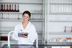 Smiling student in science writing on a clipboard Royalty Free Stock Photo