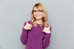 Smiling student showing thumbs up Stock Photography