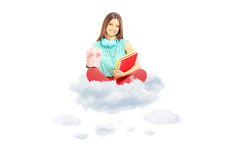 Smiling student sitting on a cloud with notebooks and popcorn b. Ox, isolated on white background stock images