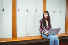 Smiling student sitting at the computer. At the university Stock Images