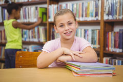 Smiling student sitting at a table. At the elementary school Royalty Free Stock Images