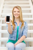 Smiling student with smartphone blank screen Royalty Free Stock Photo