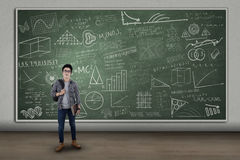 Smiling student standing at class Royalty Free Stock Image