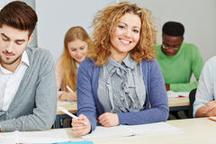 Smiling student in study course. In a university Royalty Free Stock Photography