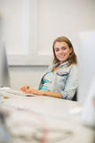 Smiling student studying in the computer room Stock Image