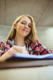 Smiling student taking notes during class Royalty Free Stock Photos
